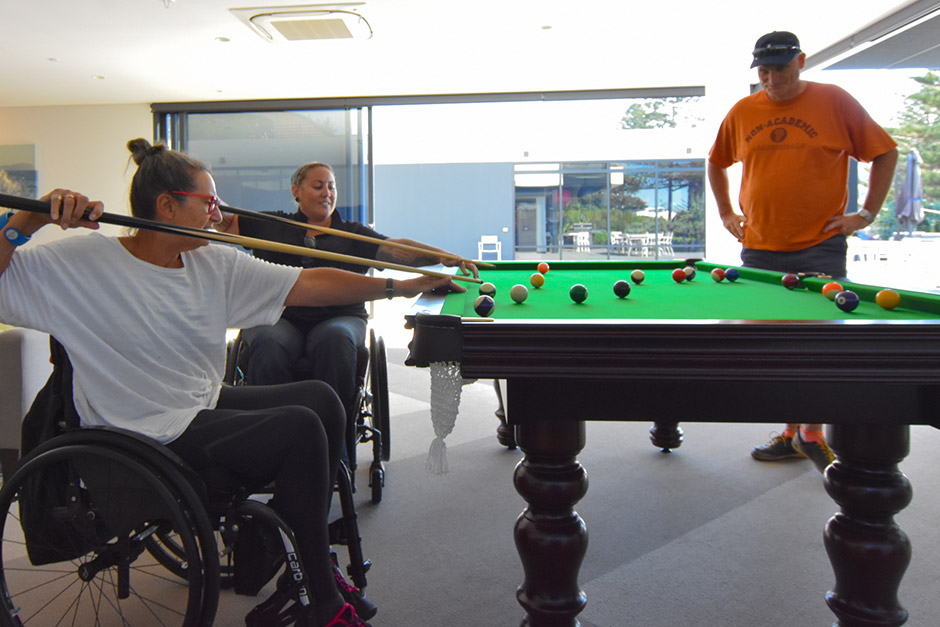 Sargood on Collaroy guests and staff playing billiards