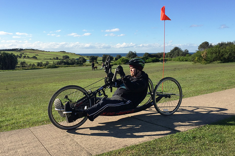 Sargood on Collaroy guest using adapted cycle at Long Reef Golf Club