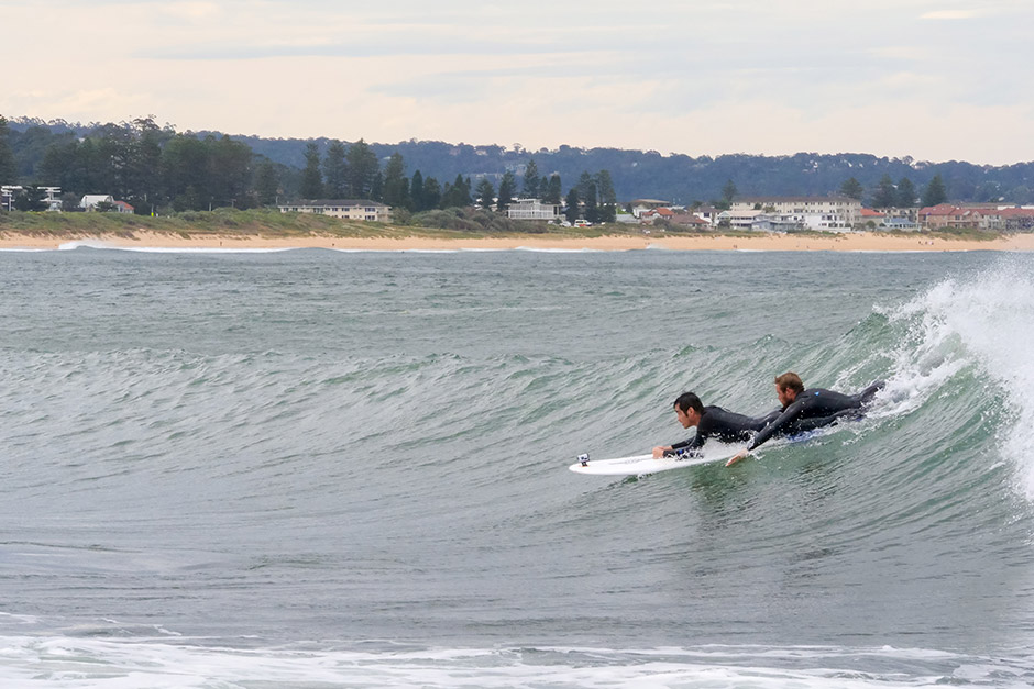Sargood on Collaroy guest surfing with in-house Adaptive Sport and Recreation Specialist at Collaroy Beach