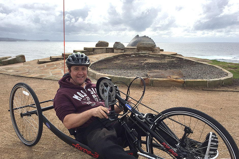 man-with-sci-cycling-collaroy-beach