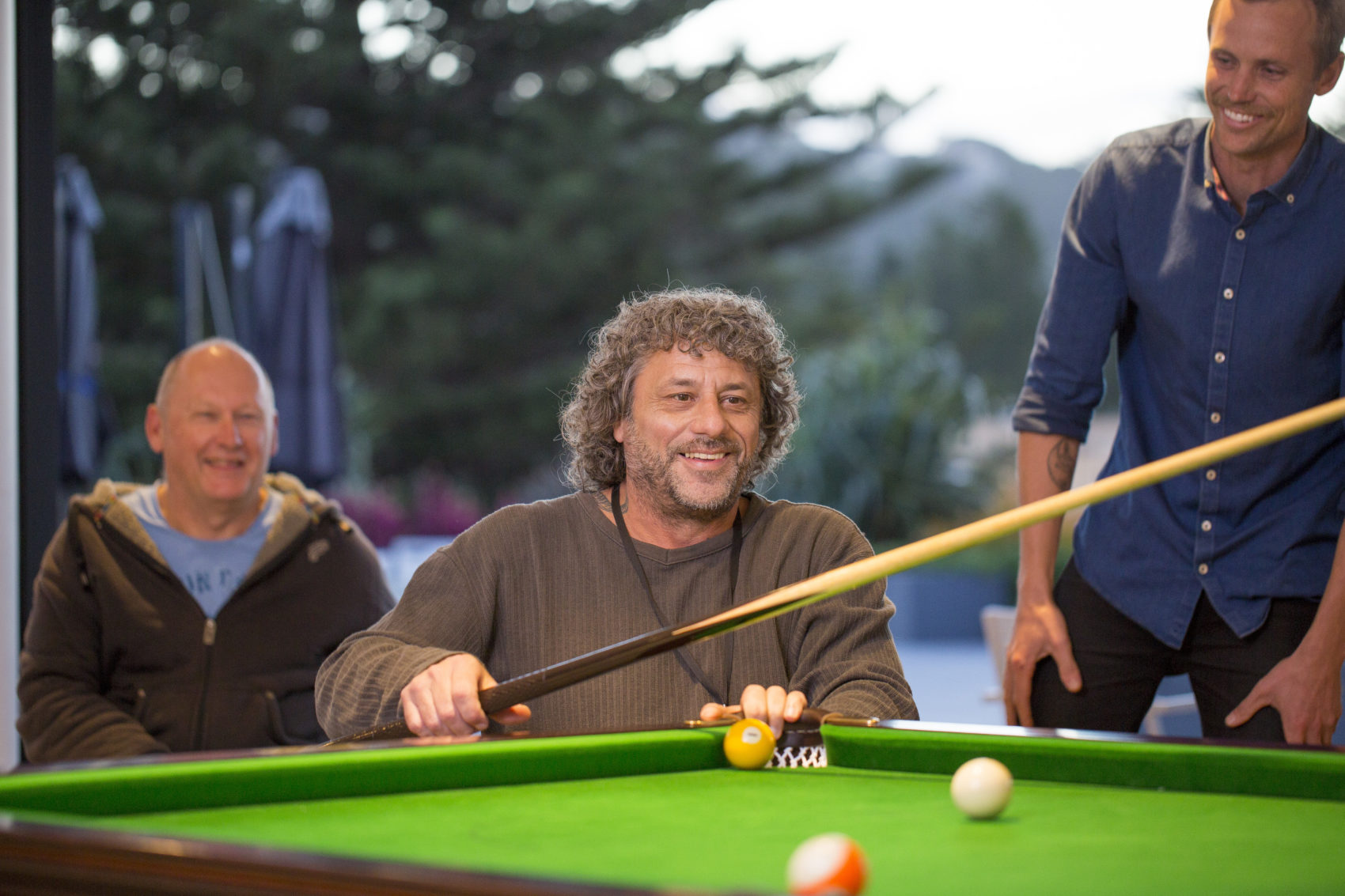 Sargood on Collaroy guests playing billiards with Adaptive Sport and Recreation Specialist